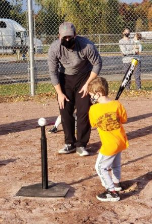 Wes with Tiny T-Ball Participant at Bat 4.jpg